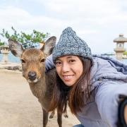 Girl taking selfie with Deer