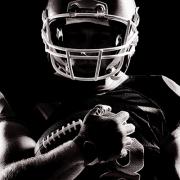 Football Player holding football