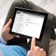 Man Reading Email on iPad