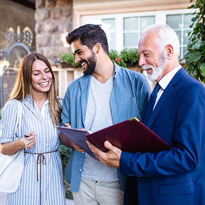 Young Couple Talking to Real Estate Agent