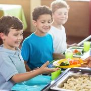 Boys Eating School Lunch