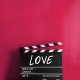 Love text title on film strip