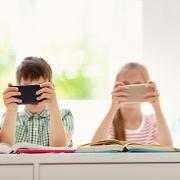 Children sitting on smartphone