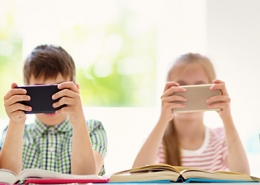 Children sitting on smartphone