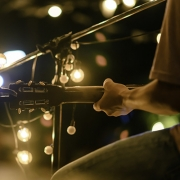 Man Sitting Playing Guitar & Singing