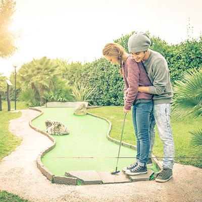 Couple Mini Golfing