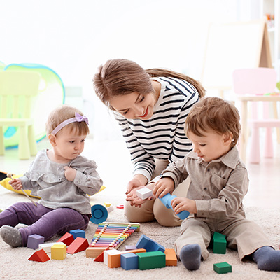 Nanny Playing with Children