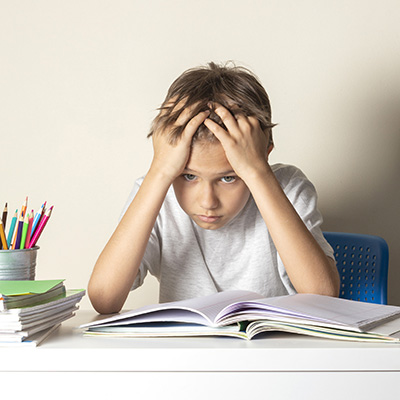 Young Boy Struggling with Math