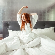 Woman Waking up from good night sleep