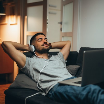 Man Listening to Music at Home