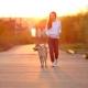 Young Girl Walking Dog
