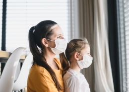 Mother & Daughter at home with masks