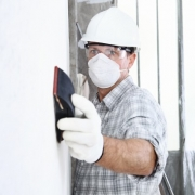 Worker in Home with mask and gloves