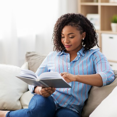African American Girl Reading Book