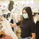 Girl with Face Mask in Shop
