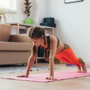 Little Girl Exercising at Home