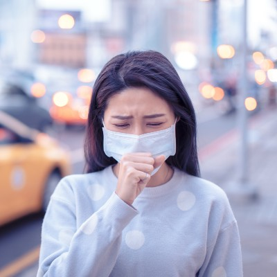 Woman Coughing with Mask On