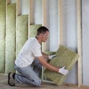 Man Insulating Home