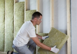 Man Insulating Home