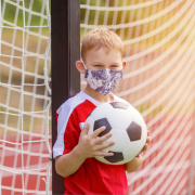 Young Boy Playing Sports with Mask