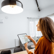 Woman Adjusting Lights in Home
